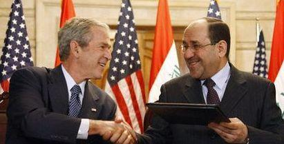 Den tidligere amerikanske præsident George W. Bush sammen med den tidligere irakiske præsident Nuri al-Maliki
